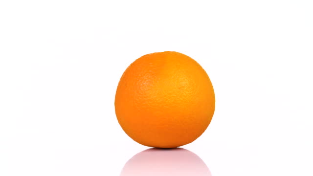 Orange rotating on white background