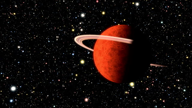 Orange rotating planet with rings video