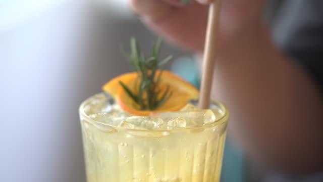 orange soda with woman hand