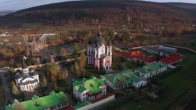 orbital aerial drone view of curchi monastery in orhei, moldova - молдавия стоковые видео и кадры b-roll