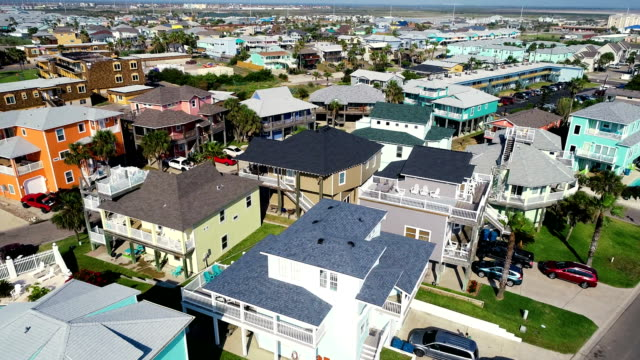 Orbiting above Padre Island Beach Sand Dunes and Vacation Rental Homes orbiting around Aerial Drone view above Padre Island Beach Sand Dunes and Vacation Rental Homes house rental stock videos & royalty-free footage
