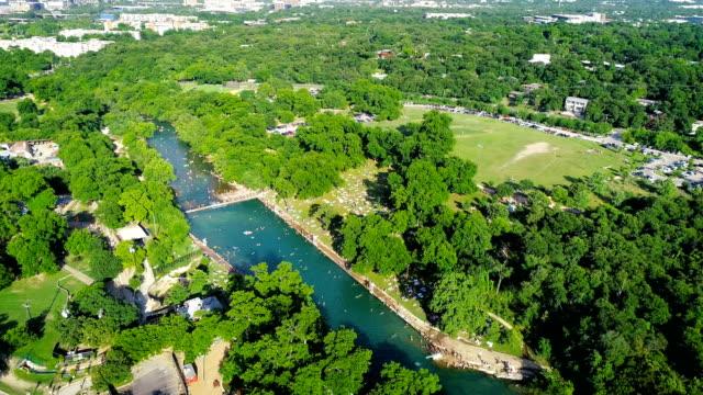Orbiting around Huge Crowds Swimming at Barton Springs Pool in Austin , Texas