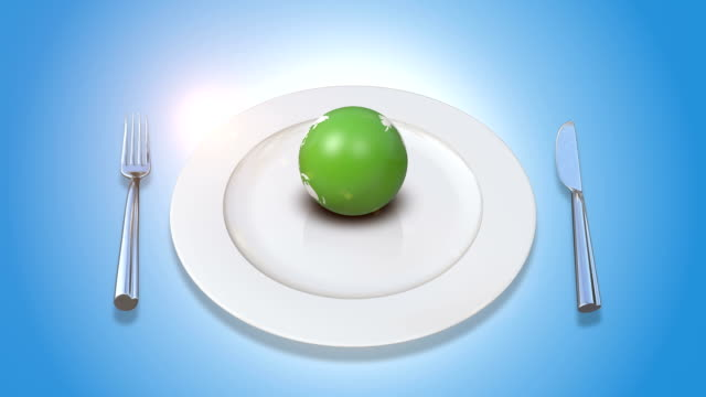 Orbiting Earth Served On Plate With Fork And Knife video