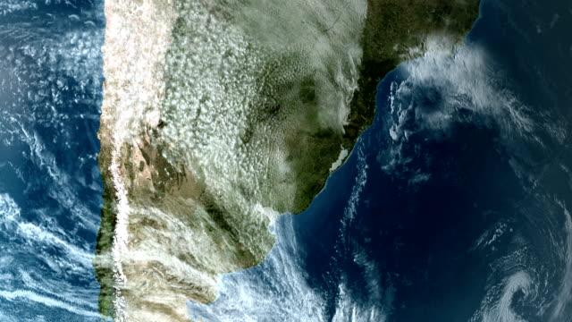 orbiting over south america 4k - oceano atlantico video stock e b–roll