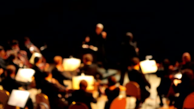 Orchestra performs a concert (out of focus) video