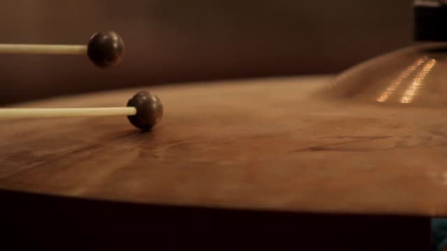 orchestral cymbal being played rhythmically using hard rubber mallets close up video