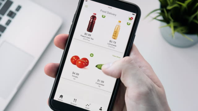 ordering food online using smartphone app - prodotti supermercato video stock e b–roll