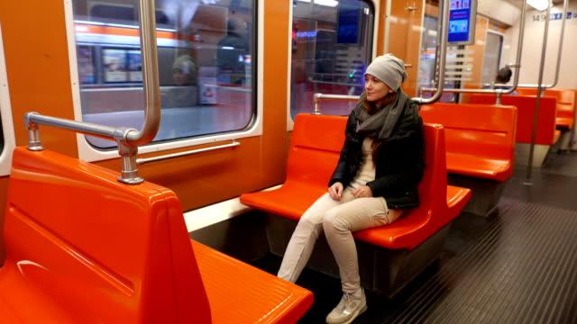Ordinary tired woman sit in empty Helsinki subway car video