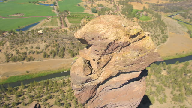 Oregon Aerial v25 Birdseye closeup view flying low around Monkey Face at Smith Rock park