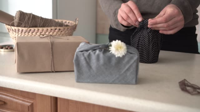 Organic Cotton Reusable Gift Wrap. The fabric is reused again and again. Zero waste concept DIY reusable cotton fabric gift wrap. Eco friendly life wrapped stock videos & royalty-free footage