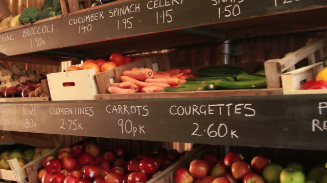 organic shop shelves of fruit and vegetables video