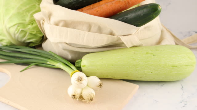 organic vegetables in shopping bag.zucchini, onion, eggplant, cucumber, carrot and cabbage - aglio cipolla isolated video stock e b–roll