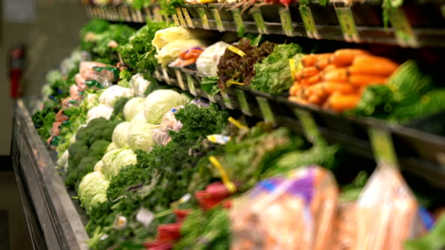 Organic vegetables on the shelves of supermarket in 4k slow motion 60fps video