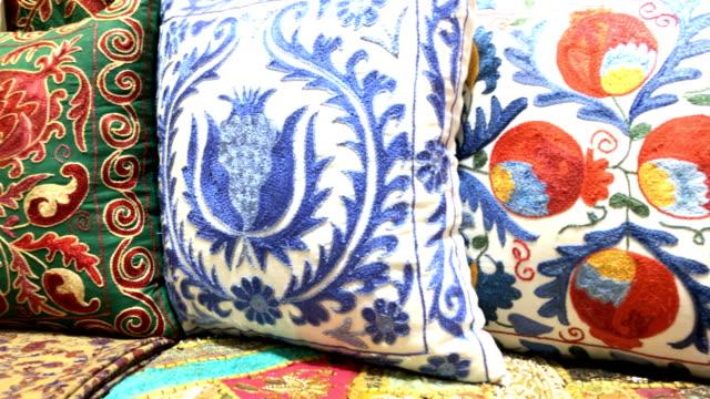 oriental pillows at grand bazaar in istanbul - souk video stock e b–roll