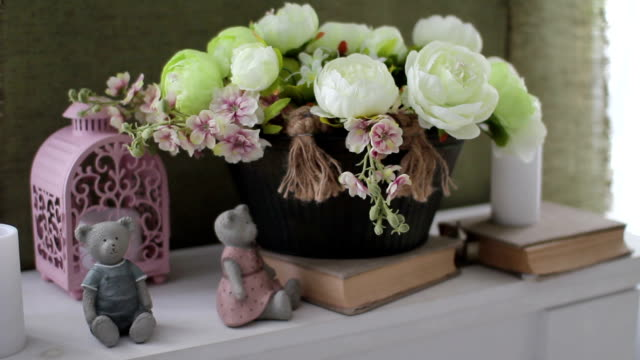 original unique photo zone with bouquet, books and bear figurines on windowsill video