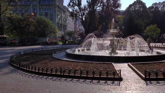 Ornate fountain splashes at city square in Europe