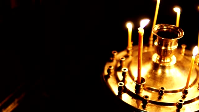 Orthodox Church, candles in the candlestick in slow motion video