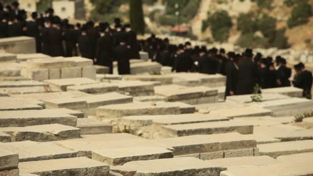 Orthodox Jews Praying in a Jerusalem Cemetery video