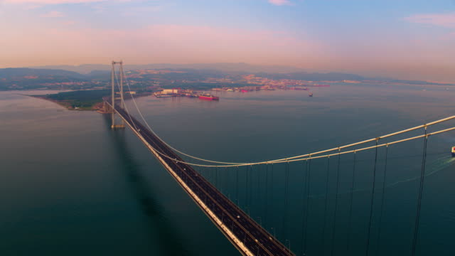 Osman Gazi Bridge From Sky. The Osmangazi Bridge (Turkish: Osman Gazi Koprusu) is a suspension bridge spanning the Gulf of İzmit at its narrowest point, 2,620 m (8,600 ft). The bridge links the Turkish city of Gebze to the Yalova Province and carries the O-5 motorway across the gulf. The bridge was opened on 1 July 2016 and surpassed the Fatih Sultan Mehmet Bridge to become the longest bridge in Turkey and the fourth-longest suspension bridge in the world by the length of its central span. suspension bridge stock videos & royalty-free footage