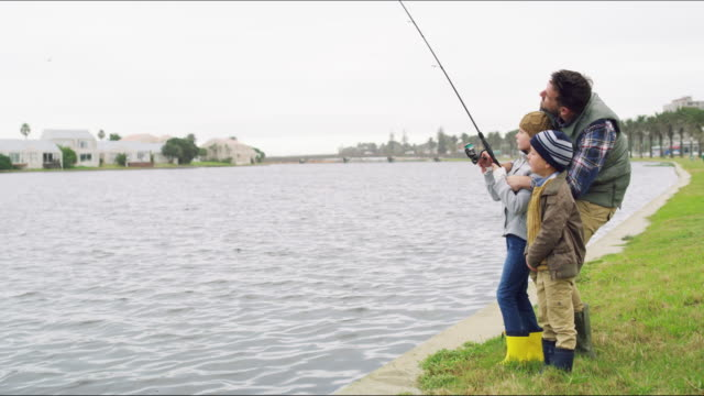 Our parent's are our first teacher's 4k video footage of an adorable little boy and girl going fishing with their father on an overcast day sister stock videos & royalty-free footage