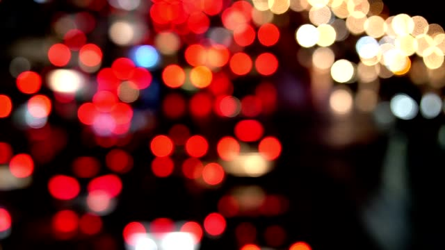 Out of focus background with blurry unfocused city lights and driving cars and car light.