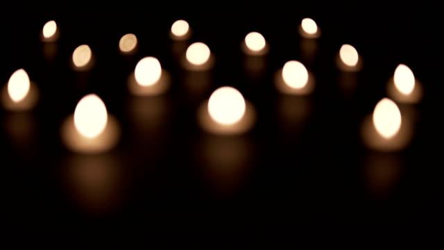 out of focus candles - jesus christ filmów i materiałów b-roll