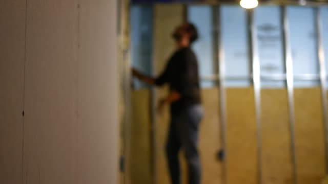 out of focus contractor looks at his unfinished basement - basement stock videos & royalty-free footage