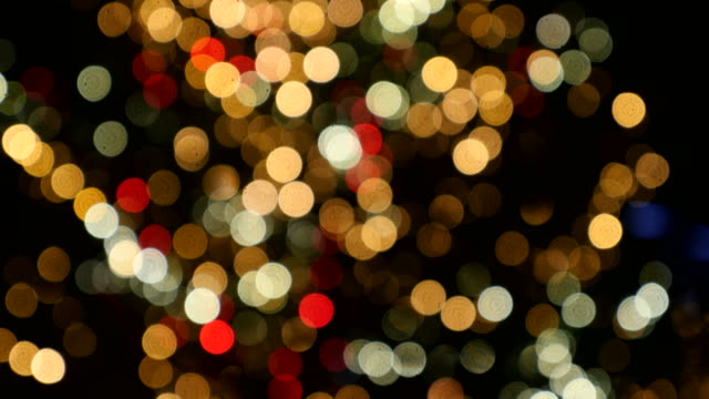 Out of focus shot of bokeh light circles on a Christmas tree, the shot is moving from the bottom to the top Out of focus shot of bokeh light circles on a Christmas tree, the shot is moving from the bottom to the top... christmas stocking stock videos & royalty-free footage
