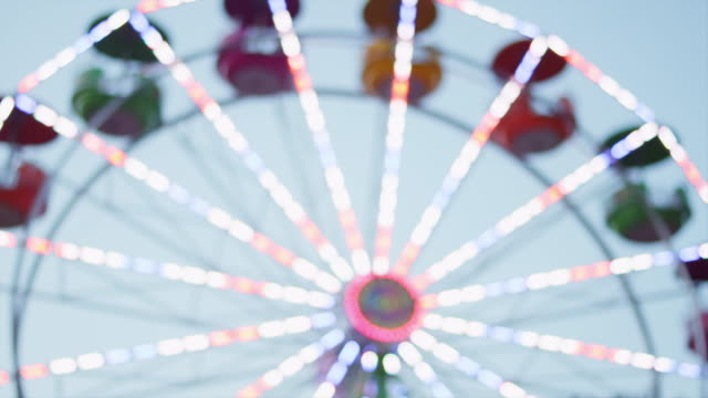 Out of focus shot of ferris wheel lights video