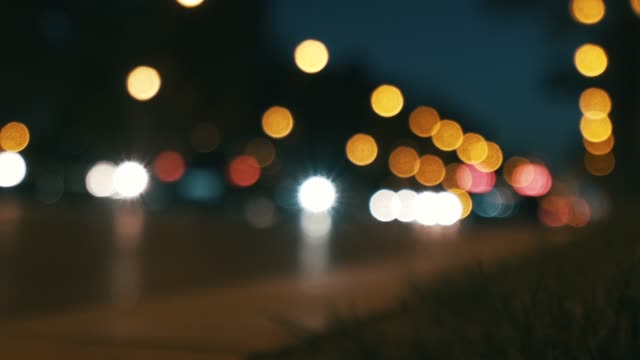 Out of focus urban life. Out of focus city life at night. low lighting stock videos & royalty-free footage
