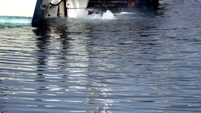 Outboard Motor At Dock Churning Up Water video