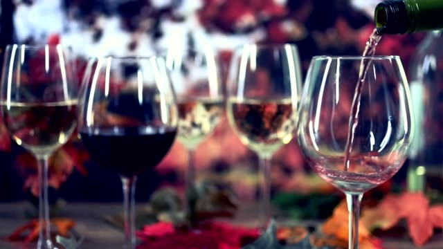 Outdoor, Autumn wine tasting event with fall leaves. video