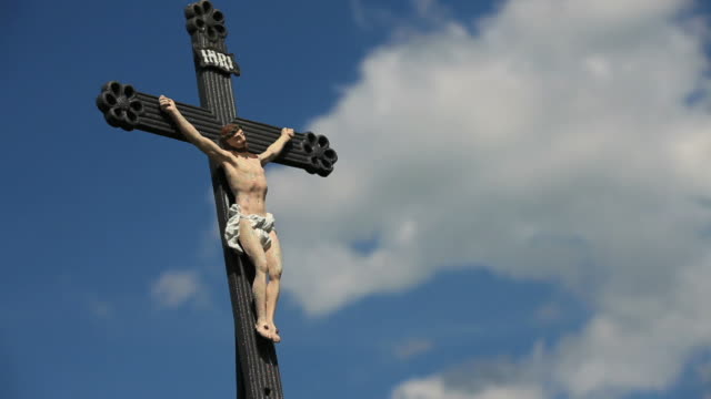 HD Outdoor crucifix against blue sky time lapse video