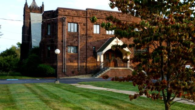 Outdoor establishing shot of presbyterian church in the evening video