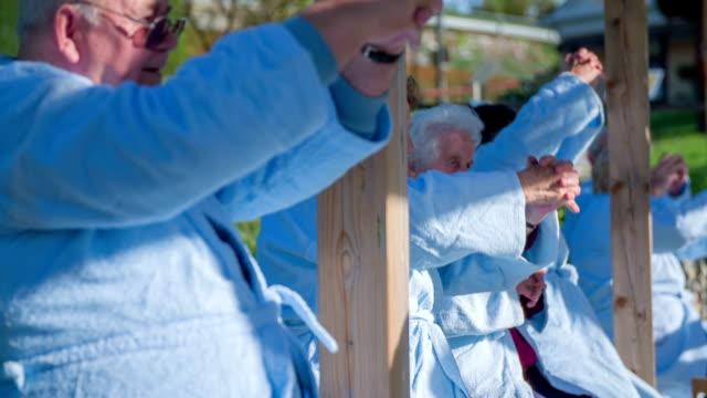 outdoor exercising with elderly people - djurkroppsdel bildbanksvideor och videomaterial från bakom kulisserna