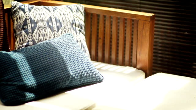 Outdoor furniture, Classic style of pillows and wooden sofa bed.
