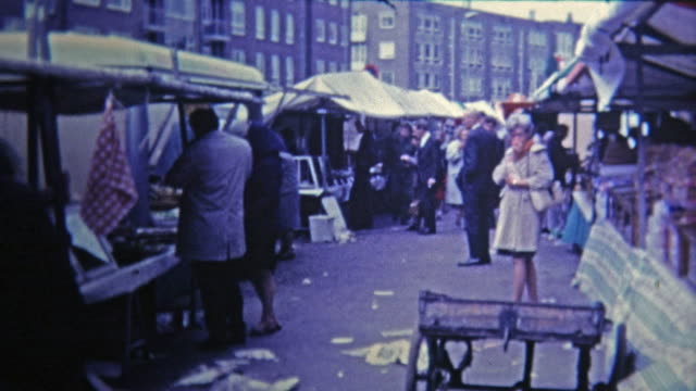 1969: Outdoor market selling dried fish and other foods and goods.