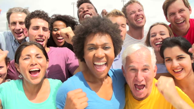 Outdoor Portrait Of Multi-Ethnic Crowd In Slow Motion