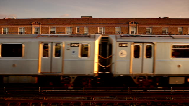 Outdoor Subway Train Arrival in Queens New York City Subway train arriving at an elevated outdoor station in Queens, New York City. subway platform stock videos & royalty-free footage