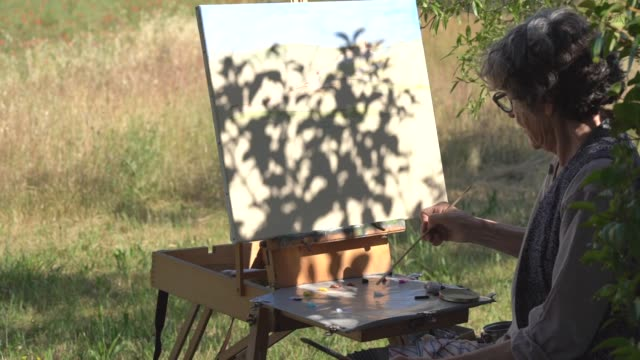 Outdoor woman painting