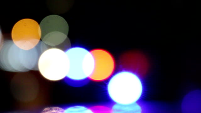 Out-of-focus flashing police car lights. video