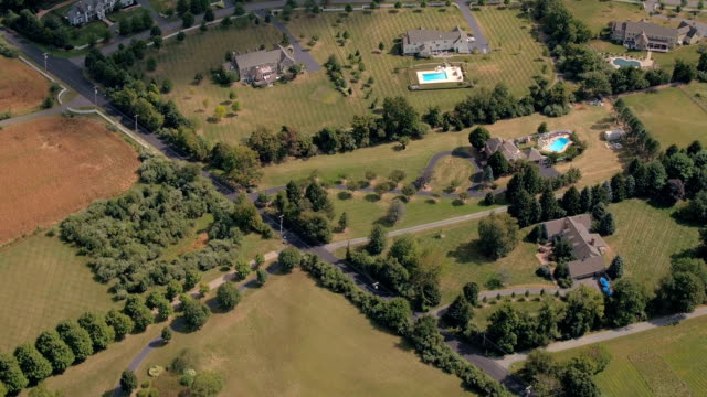 AERIAL: Outstanding luxury real estates with swimming pools in suburban town video