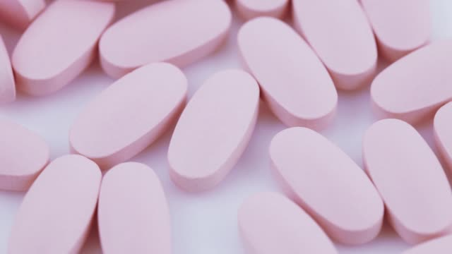Oval pink tablets on plate video