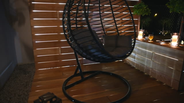 Oval Shape Chair On Wooden Deck.