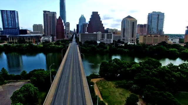Over Congress Avenue Crossing Congress Bridge flying right up to Austin Texas Downtown Congress View video