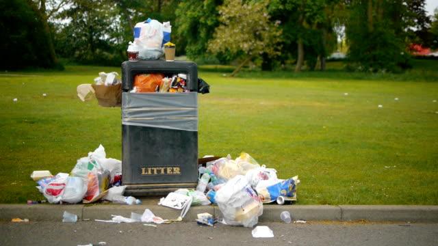 Over flowing litter bin. video