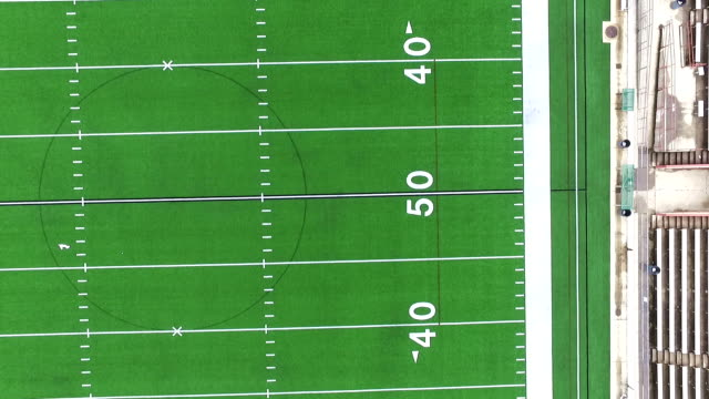 over football field looking straight down aerial stadium - football field stock videos & royalty-free footage