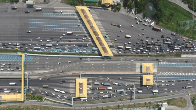 Over Head Shot of  Expressway Toll Gate with Many Vehicles Passing Through and Pay Fee, Aerial Video