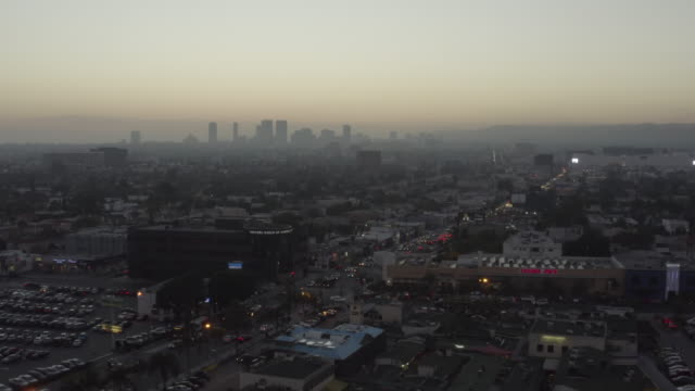 AERIAL: Over Shopping Street Fairfax Los Angeles, California // at Sunset