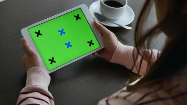 Over shoulder shot of Holding Using digital tablet, Green screen video